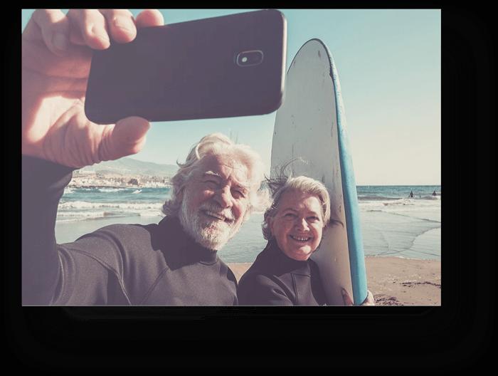 Older-Couple-Taking-Selfie-Surf-Board